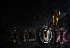 Tangent och lås för tappning guld- arkivfoto