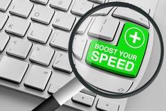 Tangentbord med grön ökning ditt hastighetsknapp och förstoringsglas fotografering för bildbyråer