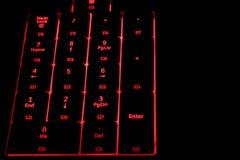 Tangentbord med rött tillbaka ljus Royaltyfria Foton