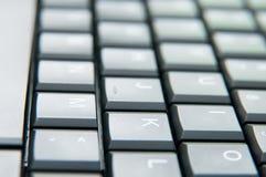 Tangentbordbokstäver Arkivbild