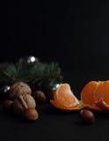 Tangerin och valnötter Arkivbild