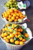 Tangerinas em um mercado Imagens de Stock Royalty Free