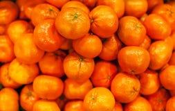 Tangerine υπόβαθρο Οργανικά ώριμα μανταρίνια στην αγορά Harve Στοκ Φωτογραφία