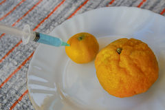 Tangerine 2 с шприцем для инкрети Стоковое Фото