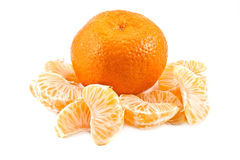 Tangerine. The whole tangerine and the parts of it Stock Photos