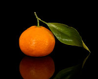 Tangerine. Fresh tangerine with leaf isolated on black Stock Photography