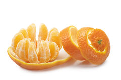 Tangerine. Peeled tangerine with segment open, on white background Royalty Free Stock Image