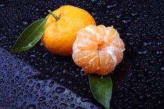 Tangerine. Isolated on dark background royalty free stock photography