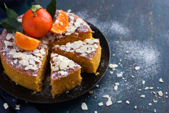 Tangerine and almond cake on dark blue background, Stock Photo