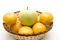 Tangerine and apple in the basket Stock Images