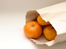 Tangerine in bag Stock Image