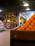 Tangerine basket. In a Hypermarket, with a background coffee store Stock Image