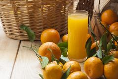 Tangerine basket and juice Stock Photo