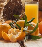 Tangerine basket and juice Royalty Free Stock Photo