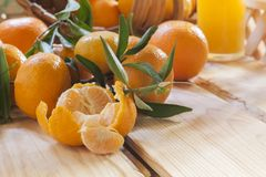 Tangerine basket and juice Stock Images