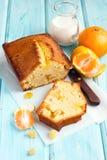 Tangerine cake. Tangerine and ginger cake sliced on wooden background Royalty Free Stock Images