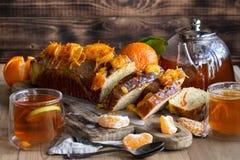 Tangerine cake with tea stock photography