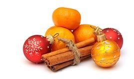Tangerine, cinnamon and chrismas balls Royalty Free Stock Photos