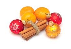 Tangerine, cinnamon and chrismas balls Stock Images