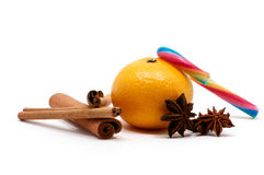 Tangerine with cinnamon sticks, candy and anise Royalty Free Stock Photo