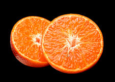 Tangerine citrus on black Royalty Free Stock Photos
