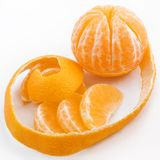 Tangerine with the cleared peel and segments Stock Photo