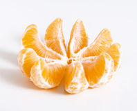 Tangerine or clementine cut at pieces. Or slices royalty free stock photography