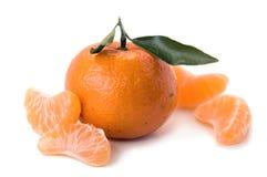 Tangerine com partes Imagens de Stock