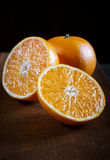 Tangerine cut on an old table. Closeup stock photography