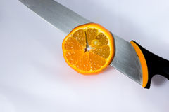 Tangerine cutted with knife Royalty Free Stock Photos
