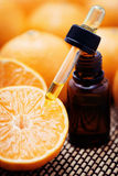 Tangerine essential oil. Bottle of tangerine essential oil - beauty treatment Royalty Free Stock Photography