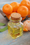 Tangerine essential oil in a glass bottle Stock Image