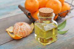 Tangerine essential oil in a glass bottle Stock Photos