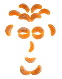 Tangerine face. Funny face created from tangerine slices with clipping path Stock Photos