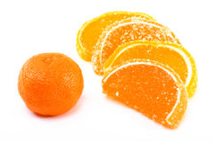 Tangerine and fruit candy segments on a white back Stock Photo