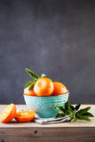 Tangerine Fruit with Green Leaves on Wooden Board Stock Photography