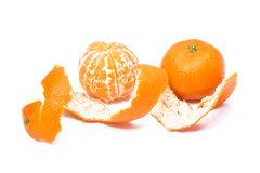 Tangerine fruit  with peeled Royalty Free Stock Images