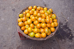 Tangerine fruit in woden wicked basket in Delhi market, India Stock Photo