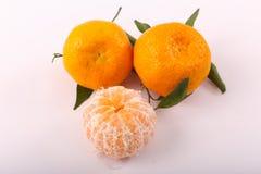 Fresh three tangerine on dish. Tangerine fruits on white background Royalty Free Stock Photo