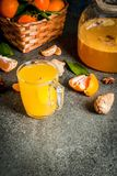 Tangerine Ginger Tea. With cinnamon and anise, with ingredients, on dark stone background, copy space Royalty Free Stock Photos