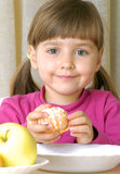 Tangerine Girl. Little girl eating fresh tangerine Stock Photography