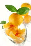 Tangerine in glass. A few tangerine with leafs in the glass like a juice stock photos