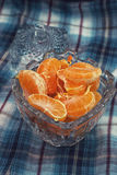 Tangerine in a glass vase Royalty Free Stock Photography