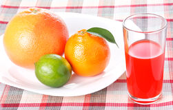 Tangerine, grapefruit, lime, glass of orange juice Royalty Free Stock Photo