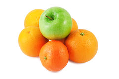 Tangerine, green apple and oranges Royalty Free Stock Photo