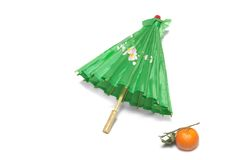 Tangerine and a green Japanese umbrella stock photography