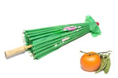 Tangerine and a green Japanese umbrella royalty free stock photography