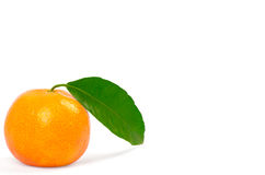 Tangerine with green leaves Stock Photo