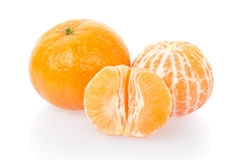 Tangerine and half. Tangerine or mandarin on white, clipping path included Royalty Free Stock Photography