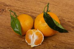 Tangerine heap. With leaves on wood background Royalty Free Stock Images